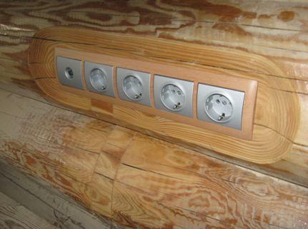 Готовые розетки в деревянном доме